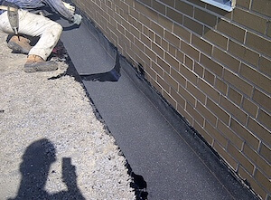 installation of flashing modified cap sheet in hot asphalt